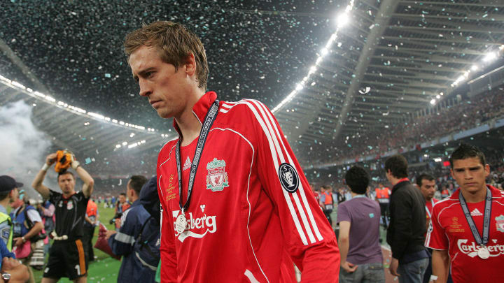 Liverpool's forward Peter Crouch  reacts...