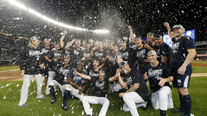 NEW YORK, NEW YORK - SEPTEMBER 19:  The New York Yankees celebrate after they clinched the American League East Division with a 9-1 win over the Los Angeles Angels at Yankee Stadium on September 19, 2019 in Bronx borough of New York City. (Photo by Elsa/Getty Images)
