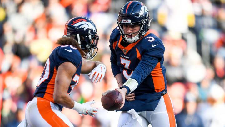 Denver Broncos running back Phillip Lindsay and QB Drew Lock