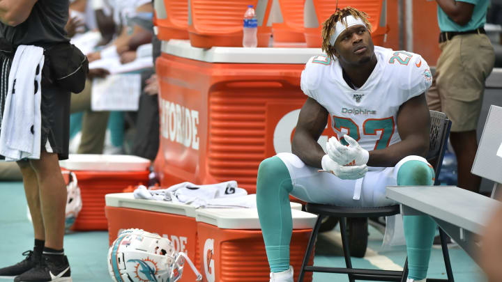 MIAMI, FL - SEPTEMBER 29: Kalen Ballage #27 of the Miami Dolphins sits on the sidelines during the fourth quarter of the game against the Los Angeles Chargers at Hard Rock Stadium on September 29, 2019 in Miami, Florida. (Photo by Eric Espada/Getty Images)