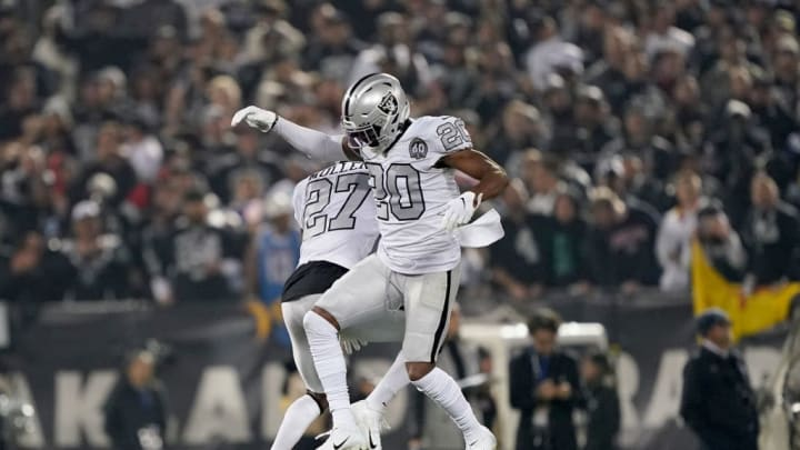 OAKLAND, CALIFORNIA - NOVEMBER 07: Daryl Worley #20 and Trayvon Mullen #27 of the Oakland Raiders celebrate after a defensive stop against the Los Angeles Chargers on third down in the third quarter at RingCentral Coliseum on November 07, 2019 in Oakland, California. (Photo by Thearon W. Henderson/Getty Images)