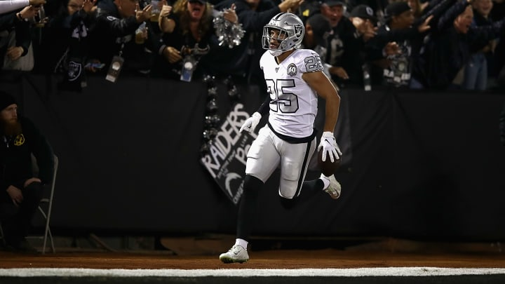 OAKLAND, CALIFORNIA - NOVEMBER 07: Free safety Erik Harris #25 of the Oakland Raiders and fans celebrate an interception return for a touchdown in the first quarter over the Los Angeles Chargers  at RingCentral Coliseum on November 07, 2019 in Oakland, California. (Photo by Ezra Shaw/Getty Images)