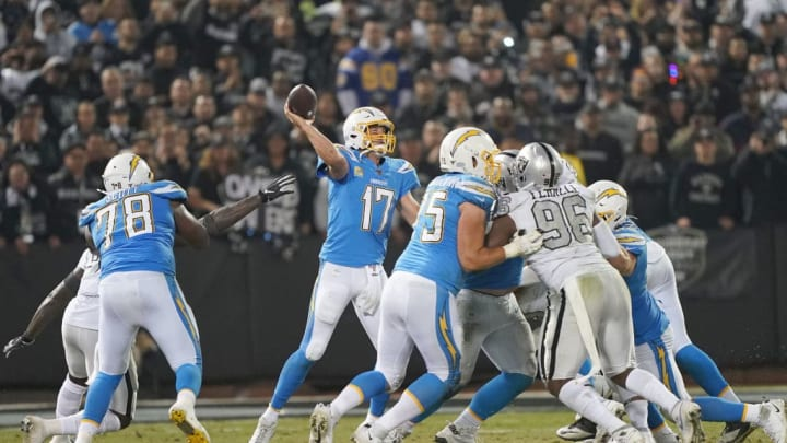 OAKLAND, CALIFORNIA - NOVEMBER 07: Philip Rivers #17 of the Los Angeles Chargers throws a pass against the Oakland Raiders during the fourth quarter of an NFL football game at RingCentral Coliseum on November 07, 2019 in Oakland, California. (Photo by Thearon W. Henderson/Getty Images)
