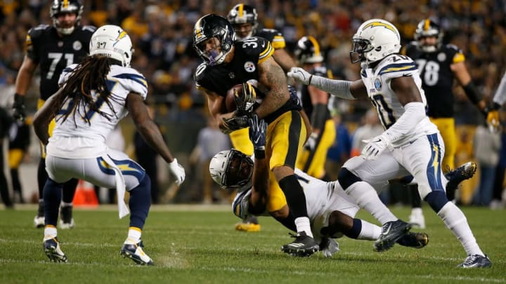 PITTSBURGH, PA - DECEMBER 02: James Conner #30 of the Pittsburgh Steelers rushes the ball against the Los Angeles Chargers in the second half during the game at Heinz Field on December 2, 2018 in Pittsburgh, Pennsylvania. (Photo by Justin K. Aller/Getty Images)