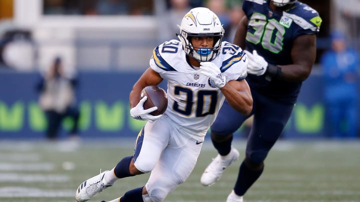 SEATTLE, WASHINGTON - NOVEMBER 04:  Austin Ekeler #30 of the Los Angeles Chargers runs with the ball in the third quarter against the Seattle Seahawks at CenturyLink Field on November 04, 2018 in Seattle, Washington. (Photo by Otto Greule Jr/Getty Images)