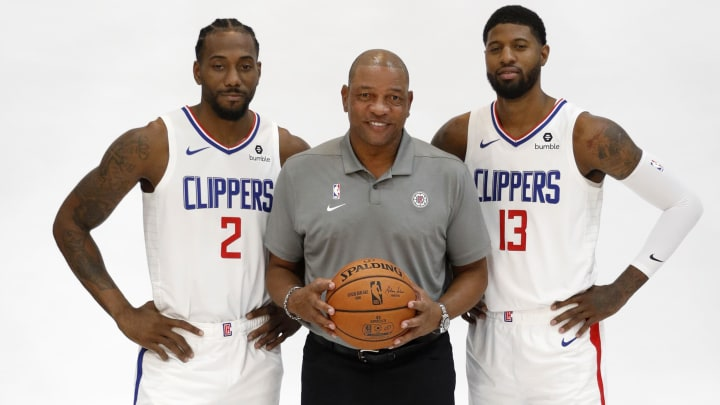 PLAYA VISTA, CALIFORNIA - SEPTEMBER 29: Kawhi Leonard #2, Paul George #13, and Head Coach Doc Rivers of the LA Clippers pose for a photograph during the LA Clippers media day at Honey Training Center on September 29, 2019 in Playa Vista, California. (Photo by Josh Lefkowitz/Getty Images)