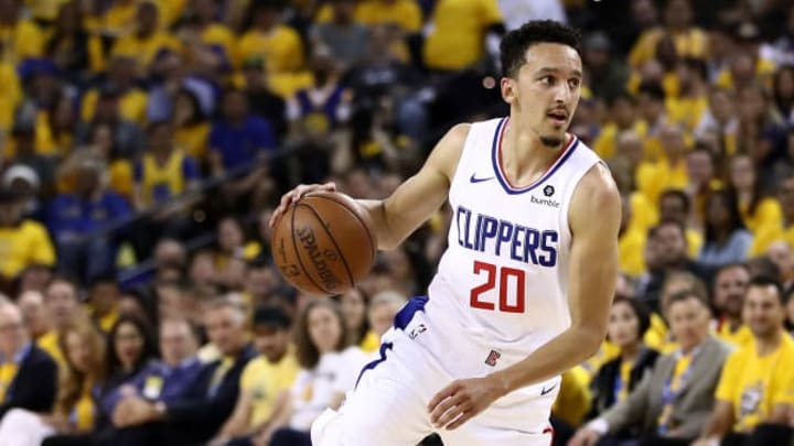OAKLAND, CALIFORNIA - APRIL 24:  Landry Shamet #20 of the LA Clippers in action against the Golden State Warriors during Game Five of the first round of the 2019 NBA Western Conference Playoffs at ORACLE Arena on April 24, 2019 in Oakland, California. NOTE TO USER: User expressly acknowledges and agrees that, by downloading and or using this photograph, User is consenting to the terms and conditions of the Getty Images License Agreement. (Photo by Ezra Shaw/Getty Images)