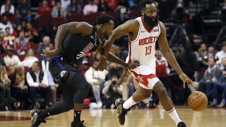 HOUSTON, TEXAS - NOVEMBER 13: James Harden #13 of the Houston Rockets brings the ball up court as Patrick Beverley #21 of the Los Angeles Clippers applies pressure during the first quarter at Toyota Center on November 13, 2019 in Houston, Texas. NOTE TO USER: User expressly acknowledges and agrees that, by downloading and/or using this photograph, user is consenting to the terms and conditions of the Getty Images License Agreement.  (Photo by Bob Levey/Getty Images)