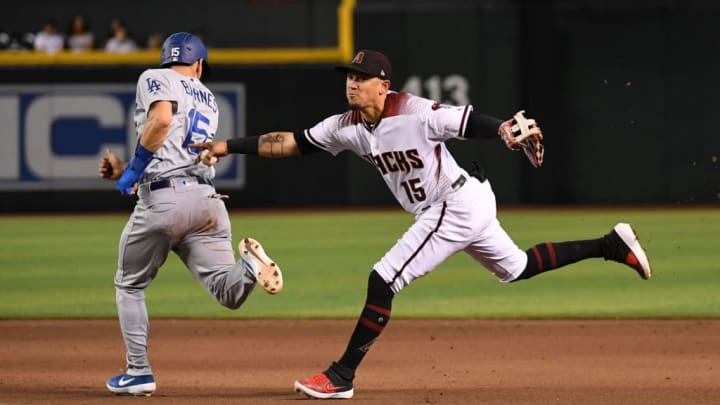 PHOENIX, ARIZONA - JUNE 26: Ildemaro Vargas #15 of the Arizona Diamondbacks tags out Austin Barnes #15 of the Los Angeles Dodgers and throws the ball to first base to get Max Muncy #13 out to complete the double play during the eighth inning at Chase Field on June 26, 2019 in Phoenix, Arizona. (Photo by Norm Hall/Getty Images)