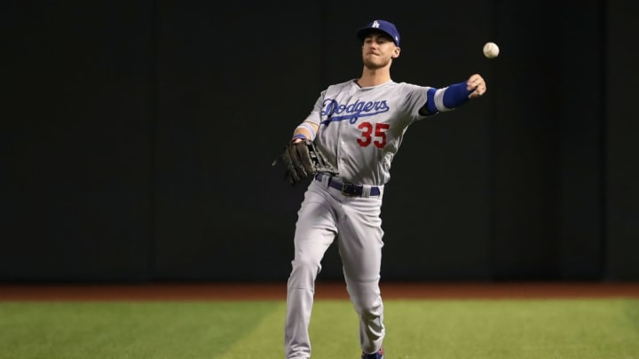 PHOENIX, ARIZONA - JUNE 24:  Outfielder Cody Bellinger #35 of the Los Angeles Dodgers fields a single during the sixth inning of the MLB game against the Arizona Diamondbacks at Chase Field on June 24, 2019 in Phoenix, Arizona. (Photo by Christian Petersen/Getty Images)