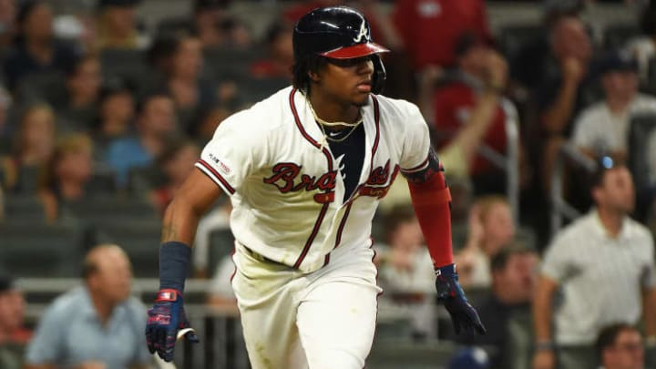 ATLANTA, GEORGIA - AUGUST 17: Ronald Acuna Jr. #13 of the Atlanta Braves bats against the Los Angeles Dodgers at SunTrust Park on August 17, 2019 in Atlanta, Georgia. (Photo by Logan Riely/Getty Images)