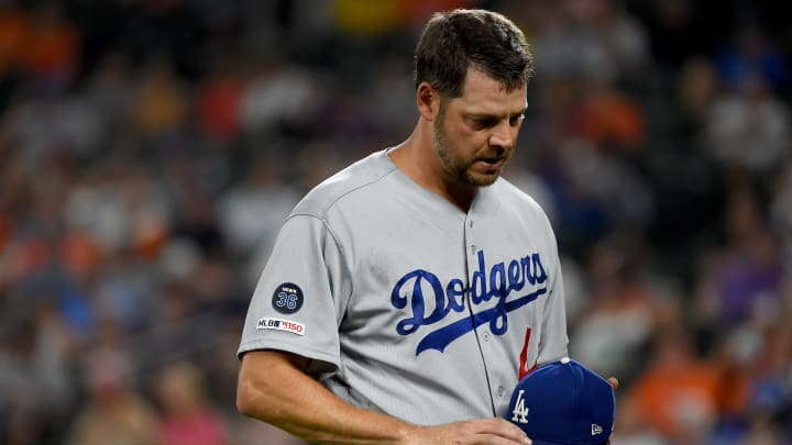 BALTIMORE, MD - SEPTEMBER 12: Rich Hill #44 of the Los Angeles Dodgers walks off the field after being pulled during the first inning against the Baltimore Orioles at Oriole Park at Camden Yards on September 12, 2019 in Baltimore, Maryland. (Photo by Will Newton/Getty Images)