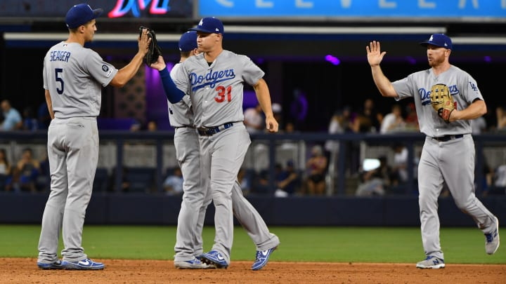 MIAMI, FL - AUGUST 14: (L-R) Corey Seager #5, Joc Pederson #31 and Kyle Garlick #41 of the Los Angeles Dodgers celebrate the win against the Miami Marlins at Marlins Park on August 14, 2019 in Miami, Florida. (Photo by Mark Brown/Getty Images)