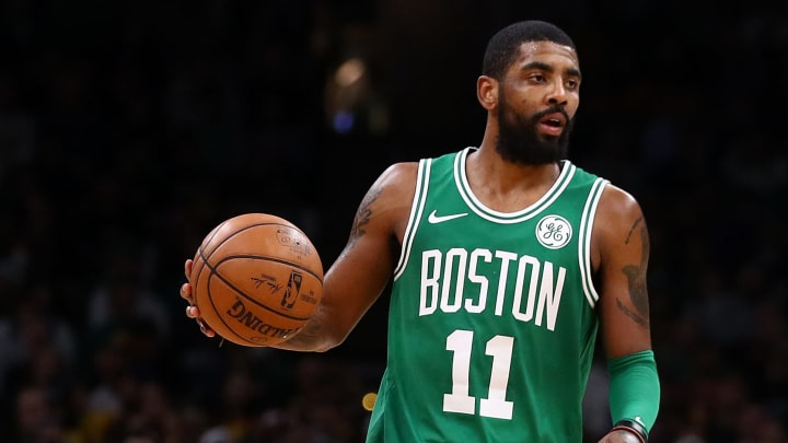 BOSTON, MASSACHUSETTS - FEBRUARY 07: Kyrie Irving #11 of the Boston Celtics dribbles against the Los Angeles Lakers  at TD Garden on February 07, 2019 in Boston, Massachusetts. NOTE TO USER: User expressly acknowledges and agrees that, by downloading and or using this photograph, User is consenting to the terms and conditions of the Getty Images License Agreement. (Photo by Maddie Meyer/Getty Images)