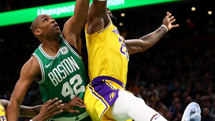 BOSTON, MASSACHUSETTS - FEBRUARY 07: LeBron James #23 of the Los Angeles Lakers and Al Horford #42 of the Boston Celtics battle for a rebound during the second quarter of their game at TD Garden on February 07, 2019 in Boston, Massachusetts. NOTE TO USER: User expressly acknowledges and agrees that, by downloading and or using this photograph, User is consenting to the terms and conditions of the Getty Images License Agreement. (Photo by Maddie Meyer/Getty Images)