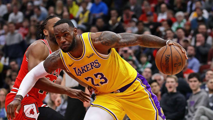 CHICAGO, ILLINOIS - MARCH 12: LeBron James #23 of the Los Angeles Lakers drives past Wayne Selden #14 of the Chicago Bulls at the United Center on March 12, 2019 in Chicago, Illinois. NOTE TO USER: User expressly acknowledges and agrees that, by downloading and or using this photograph, User is consenting to the terms and conditions of the Getty Images License Agreement. (Photo by Jonathan Daniel/Getty Images)