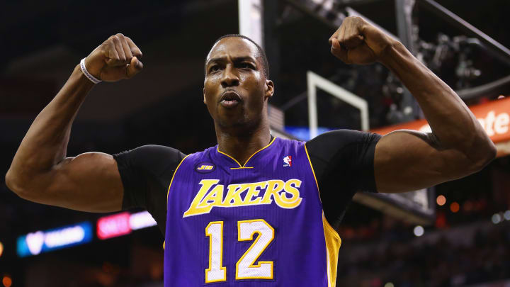 SAN ANTONIO, TX - APRIL 24:  Dwight Howard #12 of the Los Angeles Lakers reacts after being fouled against the San Antonio Spurs during Game Two of the Western Conference Quarterfinals of the 2013 NBA Playoffs at AT&T Center on April 24, 2013 in San Antonio, Texas. NOTE TO USER: User expressly acknowledges and agrees that, by downloading and or using this photograph, User is consenting to the terms and conditions of the Getty Images License Agreement.  (Photo by Ronald Martinez/Getty Images)