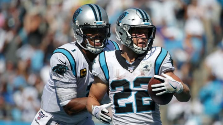 CHARLOTTE, NORTH CAROLINA - SEPTEMBER 08: Teammates Cam Newton #1 and Christian McCaffrey #22 of the Carolina Panthers react after McCaffrey scores a touchdown during their game against the Los Angeles Rams at Bank of America Stadium on September 08, 2019 in Charlotte, North Carolina. (Photo by Streeter Lecka/Getty Images)