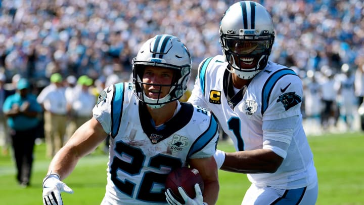 CHARLOTTE, NORTH CAROLINA - SEPTEMBER 08: Cam Newton #1 of the Carolina Panthers  and Christian McCaffrey #22 of the Carolina Panthers celebrates after a touchdown in the fourth quarter during their game against the Los Angeles Rams at Bank of America Stadium on September 08, 2019 in Charlotte, North Carolina. (Photo by Jacob Kupferman/Getty Images)
