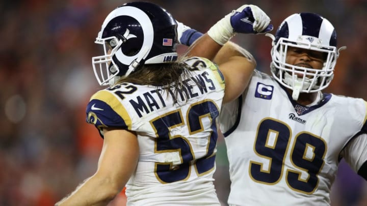 CLEVELAND, OHIO - SEPTEMBER 22: Clay Matthews #52 of the Los Angeles Rams celebrates a fourth quarter tackle with Aaron Donald #99  during a game against the Cleveland Browns at FirstEnergy Stadium on September 22, 2019 in Cleveland, Ohio. (Photo by Gregory Shamus/Getty Images)