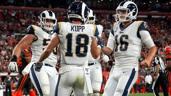 CLEVELAND, OH - SEPTEMBER 22:  Cooper Kupp #18 of the Los Angeles Rams is congratulated by Jared Goff #16 after scoring a touchdown during the third quarter of the game agains the Cleveland Browns at FirstEnergy Stadium on September 22, 2019 in Cleveland, Ohio. Los Angeles defeated Cleveland 20-13. (Photo by Kirk Irwin/Getty Images)