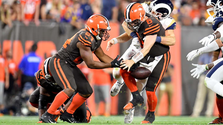 CLEVELAND, OHIO - SEPTEMBER 22: Running back Nick Chubb #24 tries to help as quarterback Baker Mayfield #6 of the Cleveland Browns looses the ball as he is tackled by outside linebacker Clay Matthews #52 of the Los Angeles Rams during the third quarter at FirstEnergy Stadium on September 22, 2019 in Cleveland, Ohio. The Rams defeated the Browns 20-13.  (Photo by Jason Miller/Getty Images)