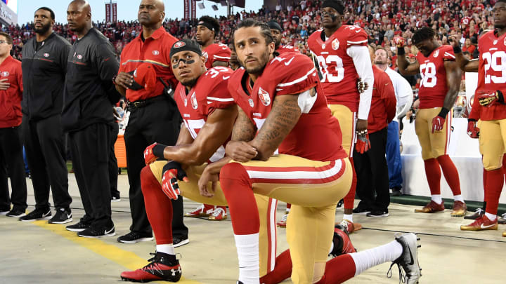 Colin Kaepernick and Eric Reid kneel during the national anthem.