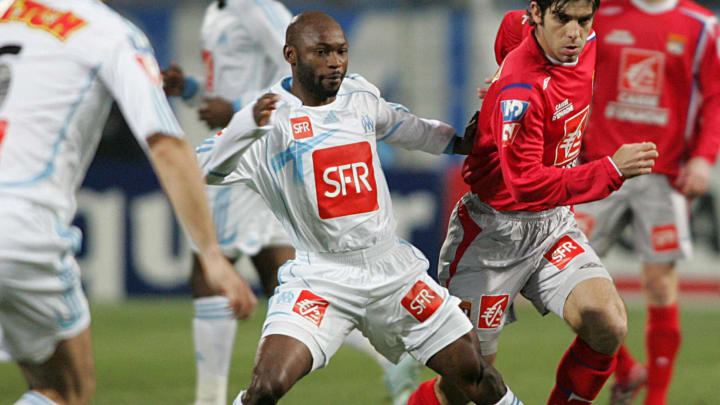 Lyon's forward Juninho (2ndR) vies with...