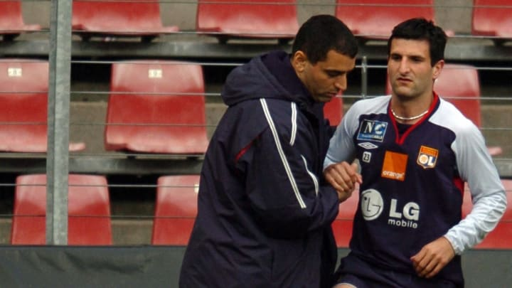 Lyon's kinesitherapist Abdel Redissi (L)