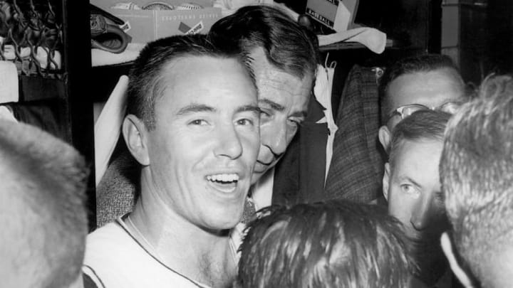 PITTSBURGH - 1960:  Bill Mazeroski #9 of the Pittsburgh Pirates talks to the media in the locker room after a 1960 World Series game against the New York Yankees at Forbes Field in Pittsburgh, Pennsylvania. (Photo by Morris Berman/MLB Photos via Getty Images)