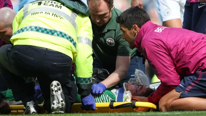 Medicla staff surround the injured Ederson in Manchester City's game against Liverpool in  2017