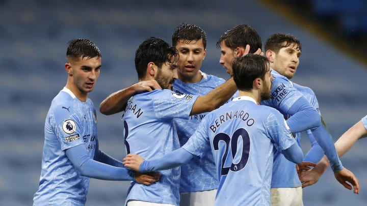 Manchester City players celebrate taking the lead on Boxing Day