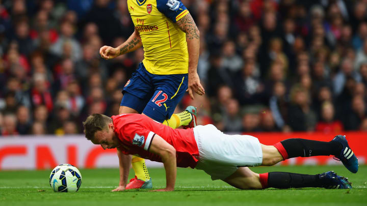 Phil Jones, Olivier Giroud