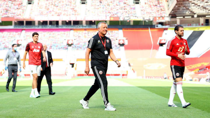 Chris Wilder checking out the Old Trafford pitch ahead of kick off