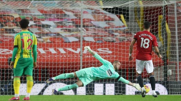 Sam Johnstone saving Bruno Fernandes' first penalty which was retaken later