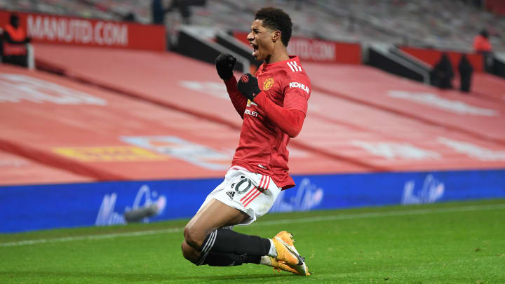 Marcus Rashford celebrates his late winner against Wolves