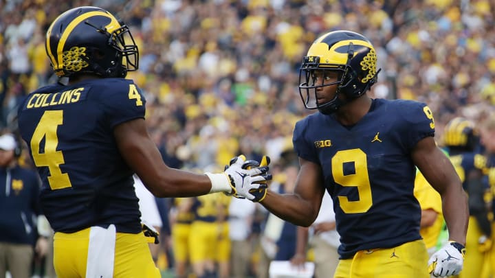 ANN ARBOR, MI - OCTOBER 06: Donovan Peoples-Jones #9 of the Michigan Wolverines celebrates a second half touchdown with Nico Collins #4 while playing the Maryland Terrapins on October 6, 2018 at Michigan Stadium in Ann Arbor, Michigan. (Photo by Gregory Shamus/Getty Images)