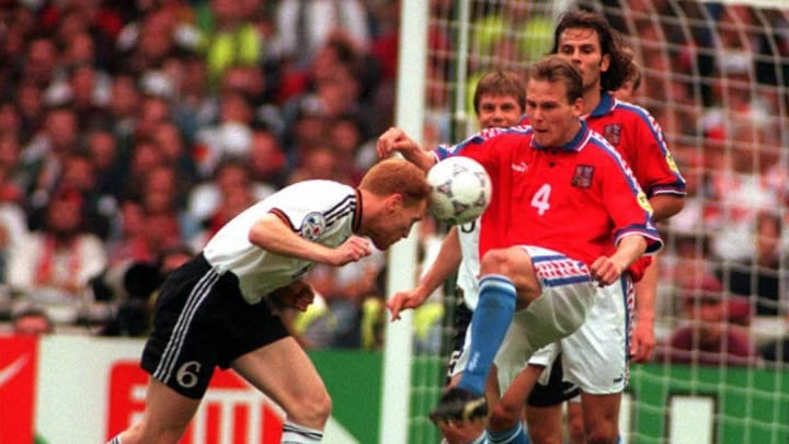 Matthias Sammer of Germany (L) heads the ball as C