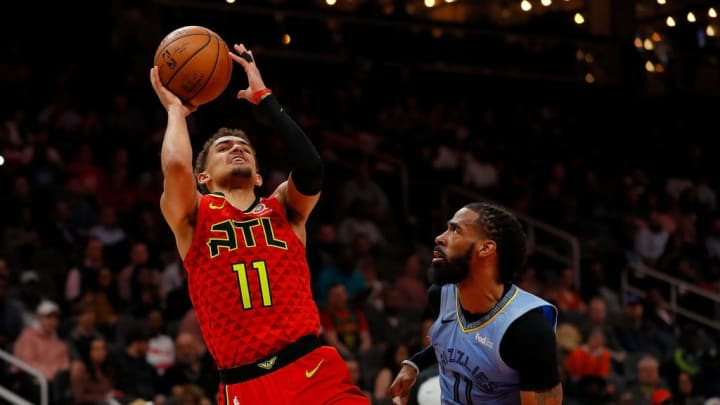 ATLANTA, GEORGIA - MARCH 13:  Trae Young #11 of the Atlanta Hawks draws a foul from Mike Conley #11 of the Memphis Grizzlies in the second half at State Farm Arena on March 13, 2019 in Atlanta, Georgia.  NOTE TO USER: User expressly acknowledges and agrees that, by downloading and or using this photograph, User is consenting to the terms and conditions of the Getty Images License Agreement. (Photo by Kevin C.  Cox/Getty Images)