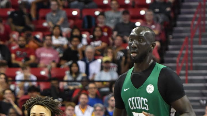LAS VEGAS, NEVADA - JULY 11:  Carsen Edwards #29 of the Boston Celtics brings the ball up the court alongside teammate Tacko Fall #55 during a game against the Memphis Grizzlies during the 2019 NBA Summer League at the Thomas & Mack Center on July 11, 2019 in Las Vegas, Nevada. The Celtics defeated the Grizzlies 113-87. NOTE TO USER: User expressly acknowledges and agrees that, by downloading and or using this photograph, User is consenting to the terms and conditions of the Getty Images License Agreement.  (Photo by Ethan Miller/Getty Images)