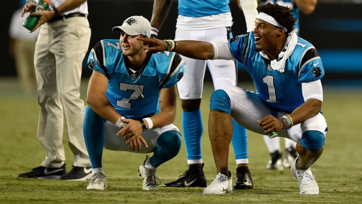 CHARLOTTE, NC - AUGUST 17:  Cam Newton #1 and teammate Kyle Allen #7 of the Carolina Panthers react after a third quarter touchdown against the Miami Dolphins during the game at Bank of America Stadium on August 17, 2018 in Charlotte, North Carolina.  (Photo by Grant Halverson/Getty Images)