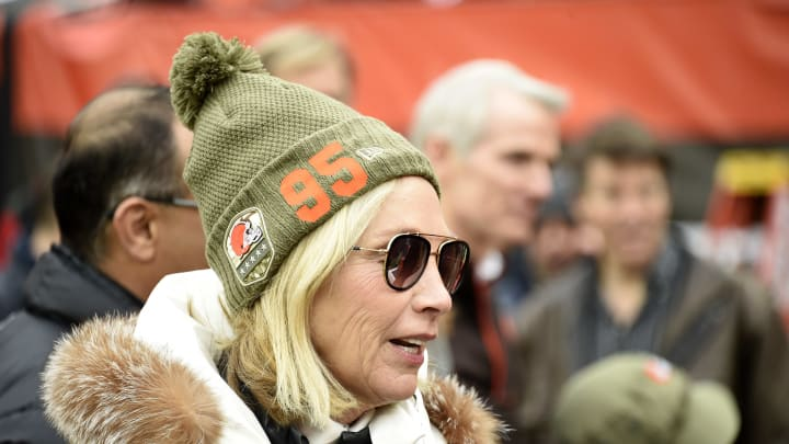 CLEVELAND, OHIO - NOVEMBER 24: Team owner Dee Haslam of the Cleveland Browns talks with guests on the sidelines while wearing a hat supporting defensive end Myles Garrett #95 prior to the game against the Miami Dolphins at FirstEnergy Stadium on November 24, 2019 in Cleveland, Ohio. (Photo by Jason Miller/Getty Images)