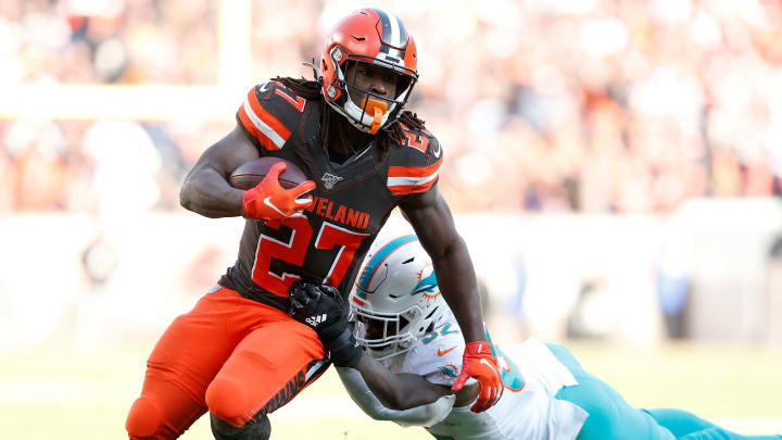CLEVELAND, OH - NOVEMBER 24:  Ken Crawley #32 of the Miami Dolphins attempts to tackle Kareem Hunt #27 of the Cleveland Browns during the game at FirstEnergy Stadium on November 24, 2019 in Cleveland, Ohio. (Photo by Kirk Irwin/Getty Images)