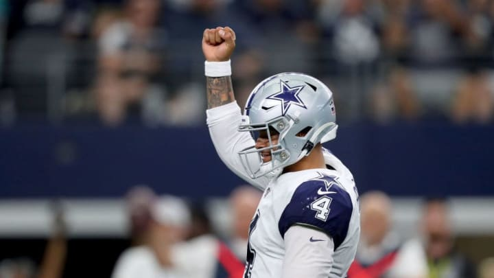 ARLINGTON, TEXAS - SEPTEMBER 22: Dak Prescott #4 of the Dallas Cowboys celebrates after throwing a touchdown  pass against the Miami Dolphins in the fourth quarter at AT&T Stadium on September 22, 2019 in Arlington, Texas. (Photo by Tom Pennington/Getty Images)