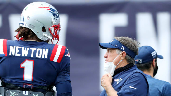 Cam Newton and Bill Belichick talk during a game.