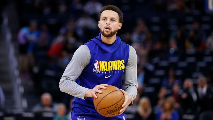 Golden State Warriors point guard Steph Curry warming up for a game against the Miami Heat.