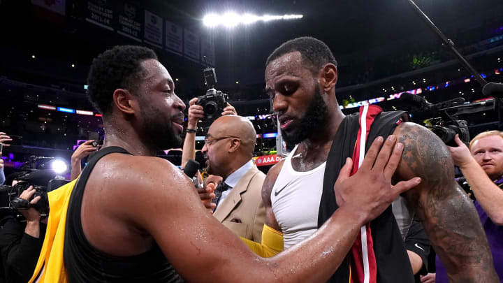 LOS ANGELES, CA - DECEMBER 10:  LeBron James #23 of the Los Angeles Lakers and Dwyane Wade #3 of the Miami Heat talk after exchanging jerseys, in Wade's last regular season game visit to Staples Center, after a 108-105 Laker win at Staples Center on December 10, 2018 in Los Angeles, California.  NOTE TO USER: User expressly acknowledges and agrees that, by downloading and or using this photograph, User is consenting to the terms and conditions of the Getty Images License Agreement.  (Photo by Harry How/Getty Images)
