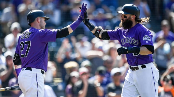 DENVER, CO - AUGUST 18:  Charlie Blackmon #19 of the Colorado Rockies is congratulated by Trevor Story #27 after hitting a sixth inning solo home run against the Miami Marlins during a game  at Coors Field on August 18, 2019 in Denver, Colorado. (Photo by Dustin Bradford/Getty Images)