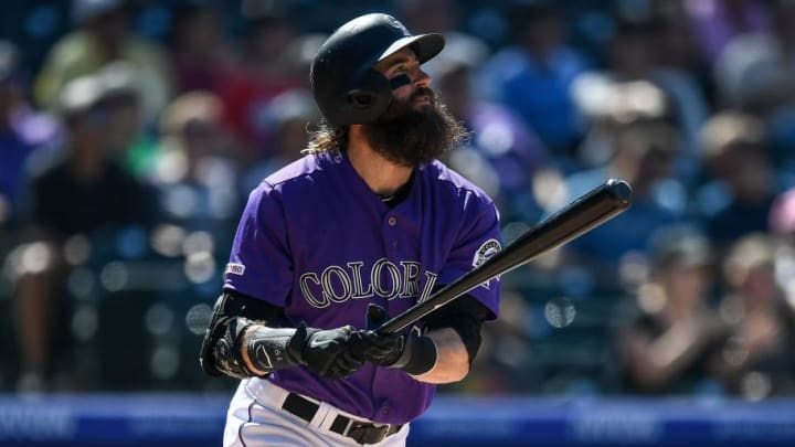 DENVER, CO - AUGUST 18:  Charlie Blackmon #19 of the Colorado Rockies follows the flight of a sixth inning solo home run against the Miami Marlins  at Coors Field on August 18, 2019 in Denver, Colorado. (Photo by Dustin Bradford/Getty Images)