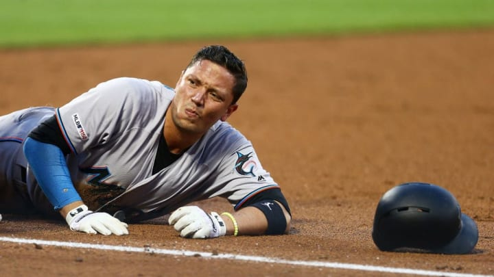 NEW YORK, NEW YORK - AUGUST 06:  Miguel Rojas #19 of the Miami Marlins reacts after being injured on a double play in the third inning against the New York Mets at Citi Field on August 06, 2019 in New York City. (Photo by Mike Stobe/Getty Images)